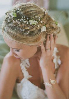 Romantic wedding hair ideas http://www.weddingchicks.com/floral-bridal-hair-ideas/