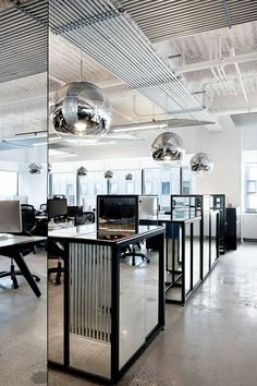 Mirror Balls, by Tom Dixon at McCann Erickson Office in New York