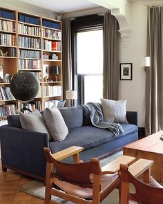 The Living Room: Custom sofa with vintage Spanish chairs by Borge Morgensen.