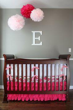 Pom Poms above crib for girl