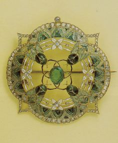 Georges Fouquet - An Art Nouveau gold, enamel, diamond and emerald 'Fly' brooch, circa 1908. 5cm diamter. Last auctioned at Christie's Geneva, 18/19 November 1981.   Source: Die Fouquet 1860-1960 - Schmuck-Künstler in Paris. #Fouquet #ArtNouveau #brooch