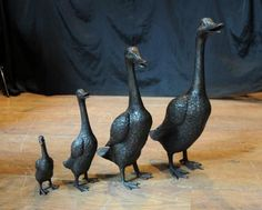 Google Image Result for http://www.porcelainpottery.org.uk/wp-content/uploads/2012/08/Bronze-Goose-Family-Geese-Bird-Fowl-Garden-Statue-Casting.jpg