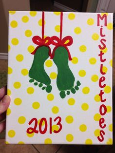 "Baby ""Mistletoes"" feet holiday art - Preston's right foot was curled up but I still think it turns out well! I used a round stencil sponge for the dots and a red paint pen for the bows and lettering! Holiday crafts. Mistletoes feet. Baby feet art. Easy peasy lemon squeezey!! Handprint Christmas Tree, Christmas Crafts For Kids, Christmas Art, Holiday Crafts, Christmas Ideas, Mistletoe Craft, Mistletoe Footprint, Baby Feet Art, Baby Art"