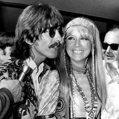George Harrison with his wife Patti Boyd (Patti Harrison) returning to the UK from the USA (Photo by Cummings Archives/Redferns)