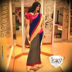 This crepe & satin saree stands out with its black and grey checkered pleats and with a unique blend of royal blue with pink and gold border, giving you a stylish and classy look.   http://www.kayfashions.in/#!/ #fashion #indian #weddings #bridal #lehenga #ghagra #anarkali #salwar #designer #ethnic #boutique #chennai #shopping #triplicane #dress #clothes #traditional #saree #sari #silksaree
