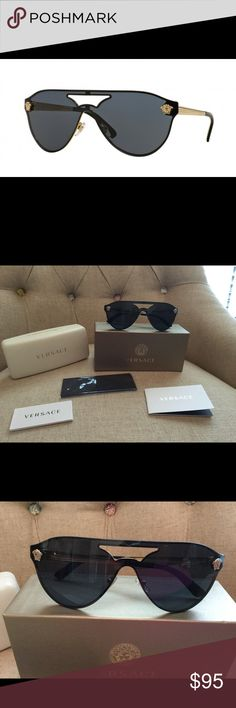 Versace VE 2161 Black &a Gold Sunglasses Versace VE 2161 gold frame sunglasses with black lenses.  No scratches.  Hardly worn.  Comes with case, box, cards and dust cloth. Versace Accessories Sunglasses