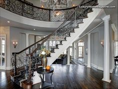 LHM Washington D.C. - Prominently sited in The Reserve. The two story foyer showcases a dramatic floating curved staircase with custom wrought iron banister. Hand planed walnut floors and custom lighting warm the interior. Family room boasts a dry stacked stone fireplace, coffered ceiling and a wall of windows. Sumptuous master bedroom with fireplace, sitting room, private covered balcony and his and her baths with walk-ins. Walk-out lower level is perfect for formal and family...
