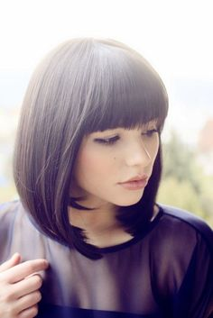 Shoulder length bob with bangs.