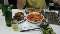 A table full of great Chinese food at a local Lanzhou restaurant: 回锅肉,西红柿炒鸡蛋,羊肉串,拍黄瓜.