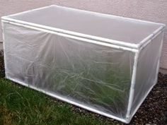 mini greenhouse made out of PVC pipes and old shower curtain liners,
