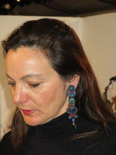 Marielle wearing Dori Csengeri's Mystique earrings.