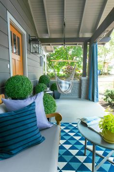 The swing/hammock!!!!! || The Asheville mountain breezes feel extra crisp and refreshing on this porch! >> http://www.hgtv.com/design/hgtv-urban-oasis/2015/articles/front-yard-from-hgtv-urban-oasis-2015?soc=pinterest