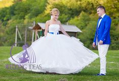 Ball strapless wedding dress with tulle and lace skirt. Blue belt in the Bride west similar like Groom jacket, bow and shoes. See other brides at http://www.e-weddingideas.com/2016/03/21/the-first-part-470-amazing-wedding-dresses-you-have-never-seen/