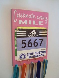 Love this race bib display!! I WANT THIS!!! perfect way to display the accomplishments and the pride in getting through each race.