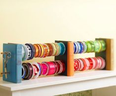 Book to Book Ribbon Hangers. Drill two sets of holes through three old books for an interesting way to display your ribbon. Thread ribbon on wooden dowels and push the dowels through the holes. This idea could also be used as a jewelry hanger. Diy Organisation, Ribbon Organization, Ribbon Storage, Diy Ribbon, Room Organization, Washi Tape Storage, Book Crafts, Paper Crafts, Paper Art