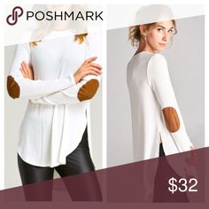 """*LAST2* Cozy Elbow Patch LS Top Available in Sizes S,M,L New with tags.  Solid Rib Textured Faux Suede Ringer Neckline and Elbow Patched Hi-Low Hemming Long Sleeve Top with Side Slit  ✔️Bundle discount: 10% off 2+ items.  ❌No trades  🛍Use the """"Buy Now"""" or """"Add to Bundle"""" feature to select your size & purchase. clmayfae Tops Tees - Long Sleeve"""