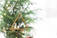 Bring elegance and modern touch to your home decor! These minimalistic and geometric ornament can accent your tree this Christmas season!  - P R O D U C T S P E C - Set of 8 Ornaments 3.5 inches per side  - M A T E R I A L U S E D - Made out of 2mm clear glass wrapped in brass, put together with solder  - M A D E T O O R D E R - - N O T E - Candles or any decorative item is not included