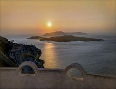 Santorini Sunset. Going down to Athinios Port. Nea Kameni and Palia Kameni Volcanoes by Mark L Edwards