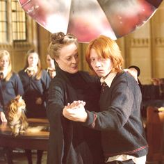 """Maggie Smith as Professor McGonagall teaching Rupert Grint, as Ron Weasley, to waltz in preparation for the Yule Ball, in """"Harry Potter and The Goblet of Fire"""", 2005"""