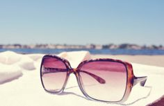 Wearing sunglasses on the beach. In the summer. Under the sun, the best feeling!