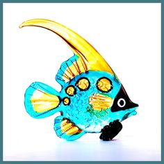 Glass Animal Figurine: a handmade tropical marine collectible.  Lampworked borosilicate glass with hand painting in shimmering blue & yellow. $12.00, via Etsy.