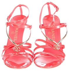 Chanel Coral Patent Leather Gold Tone Interlocking Cc Logo Strappy 39.5 9.5 Red, Gold Sandals. Get the must-have sandals of this season! These Chanel Coral Patent Leather Gold Tone Interlocking Cc Logo Strappy 39.5 9.5 Red, Gold Sandals are a top 10 member favorite on Tradesy. Save on yours before they're sold out!
