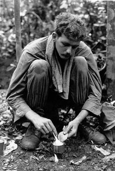 This picture demonstrates a common practice among troops in the field of using C4 plastic explosive to heat C-rations. (1969)