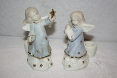 "set of 2 porcelain angel figurine candle holders measurements are approx: holding baby 5"" x 4"" x 2"", with star 5 1/4"" x 4"" x 2"". Hold taper candles (not included) MINT $12.50"