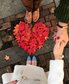 I like the leaf heart, but surely it could be incorporated into the picture in a way that also includes their faces?
