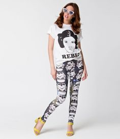 Take your best shot, dames! These stellar Star Wars themed leggings are crafted in a lovely stretch fabric with a galaxy print on black and boasting the helmets of Storm Troopers throughout. With an easy pull on design and banded natural waist, you'll rec