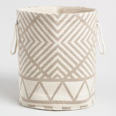 Designed, handwoven and embellished by local craftspeople, our extra-thick fabric tote makes a striking statement in a chic gold geo print. Featuring rope handles and a soft but sturdy silhouette, it makes a stylish home for a houseplant or clutter of any kind.