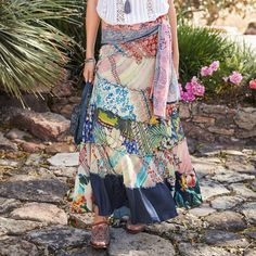 """GYPSY ESSENCE SKIRT--A tiered maxi skirt with elastic waist and front gather. Lined. Silk/rayon. Machine wash. Imported. Catalog exclusive. Sizes XS (2), S (4 to 6), M (8 to 10), L (12 to 14), XL (16). Approx. 41-1/4""""L."""