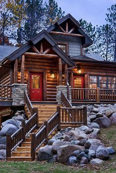 Mountain Cabin. There is a garage in back. The laundry room is next to the kitchen that goes to the dining room. The living room is next to a study and a small bathroom. There is a loft upstairs with a wide hall that goes to a large bedroom and bathroom. Out back there is a patio and a hot tub.