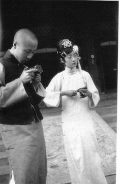 Henry Pu-yi and Empress Wanrong. Last Emperor of China. How young do these two look? They are already married/engaged!!