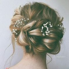 Messy updo with floral trimmings