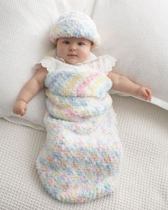 Keep baby feeling warm and safe with this adorable cocoon and hat set. Shown in Bernat Pipsqueak.