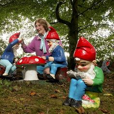 Image: Ann Atkin, owner of the Gnome Reserve & Wild Flower Garden, performs the annual task of giving the gnomes a new lick of paint in Devo...