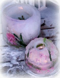 Jäälyhty kakkuvuokaan tehtynä, koristeina hyasinttia
