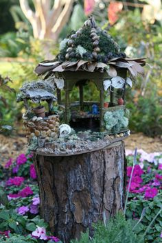 "Don't quite pull out that dead tree stump in your backyard just yet. Just add a nice thick coat of wood stain, miniature plans, miniature accessories, borrow some gorilla glue, and PRESTO.You have INSTA-Miniature Tree Stump ""Fairy Garden"". Fairy Garden Houses, Gnome Garden, Garden Art, Home And Garden, Garden Gazebo, Garden Homes, Garden Studio, Fairy Furniture, Fairy Doors"