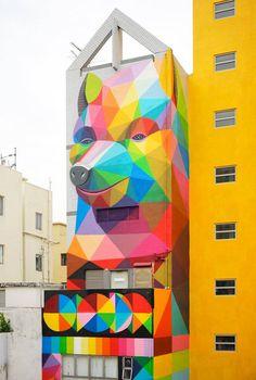 okuda san miguel adds rainbow thief to a narrow residence in hong kong Grafitti Street, Hong Kong Art, 3d Optical Illusions, Street Installation, Okuda, Illusion Art, Hand Art, Pop Surrealism, Street Artists