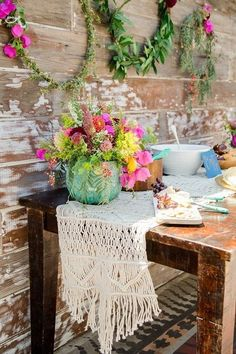 bohemian macrame wedding tabler runner with wildflowers centerpiece / http://www.deerpearlflowers.com/boho-macrame-knotted-wedding-decor-ideas/