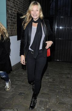 Enjoying herself: The 41-year-old was spotted smiling from ear to ear when she was spotted stepping out in north London