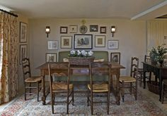 Wonderful canine art grouping in English cottage dining room - Thurston/Boyd