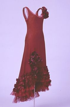 "Evening Dress, Norman Hartnell: ca. 1929, silk chiffon, velvet. ""This dress was worn by Anne, Countess of Rosse, she was photographed wearing it in Vogue in 1929."""