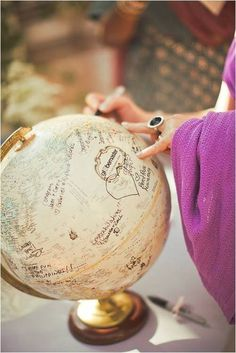 Globe guest book at wedding. Great way to start your new journey together! Something different