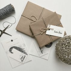 Kraft brown paper, jute and black and white bakers twine coupled with Kerry Lyons monochrome gift tags = effortlessly chic giftwrap