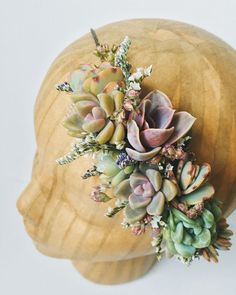 A delicate crown of succulents and dried blossoms on a wrapped wire form. Shades of purple, dusty pink, mint green, etc. Easy to wear and long lasting- perfect for parties, engagement photos, and weddings. Fits any size head. Can be ordered in advance by including your wedding date in the notes