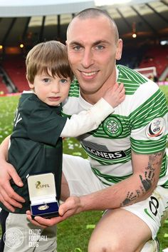Scott Brown shows off his winners medal with his son during the Scottish League Cup celebrations at Hampden Park.