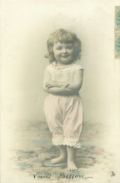 vintage photograph of child hands & arms crossed over her stomach