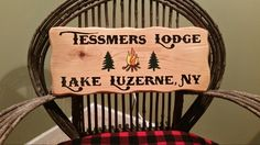 Carved Cedar family camp sign by Adirondack Jim